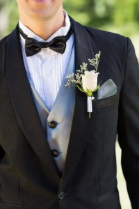 7811295-midsection-of-groom-wearing-boutonniere